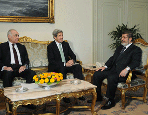 John Kerry in a pre-June meeting with then Egyptian Foreign Minister Mohammed Kamel Amr, and then-President Mohammed Morsi