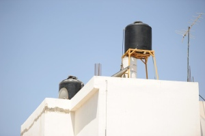 Rooftop water cisterns in Jenin.