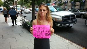 A protester from Code Pink outside the National Leadership Assembly for Israel.