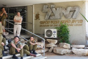 Israeli soldiers lounge outside the museum of the Zionist militant group, the Irgun Zvai Leumi.